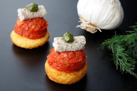 CRO002 Potato blini Olive tapenade, roasted tomatoes